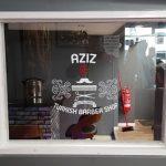 Shops-Aziz Barbers Window 2018