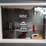Shops-Aziz Barbers Window 2018